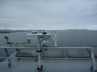 Long- and short-wave radiation sensors mounted on disk on RV Investigator, port side above bridge.